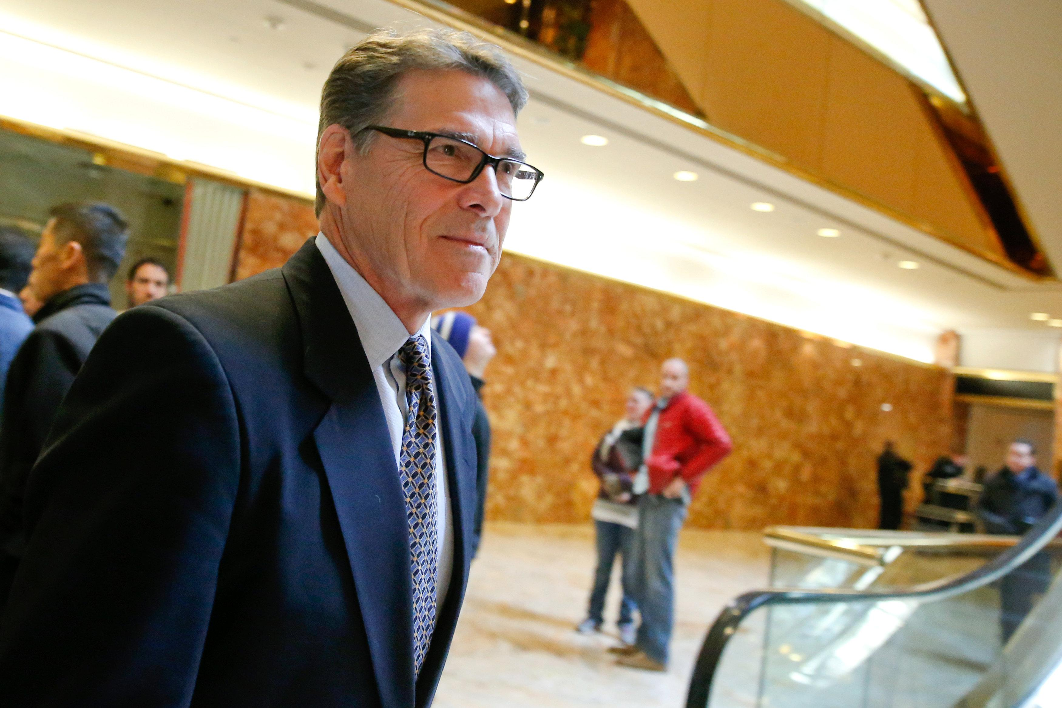 Former Texas Governor Rick Perry exits after meeting with U.S. President-elect Donald Trump at Trump Tower in Manhattan, New York