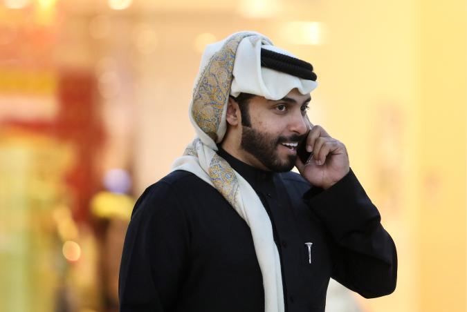 DOHA, QATAR - DECEMBER 11, 2017: A Muslim man talks on the phone at Villaggio Mall. Valery Sharifulin/TASS (Photo by Valery Sharifulin\TASS via Getty Images)