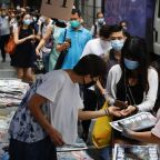 Emotions run high as HK bids farewell to pro-democracy newspaper Apple Daily