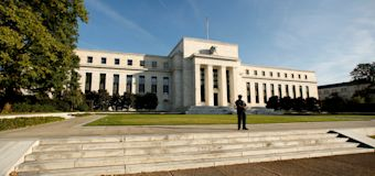 Fed holds rates, sets date to unwind balance sheet
