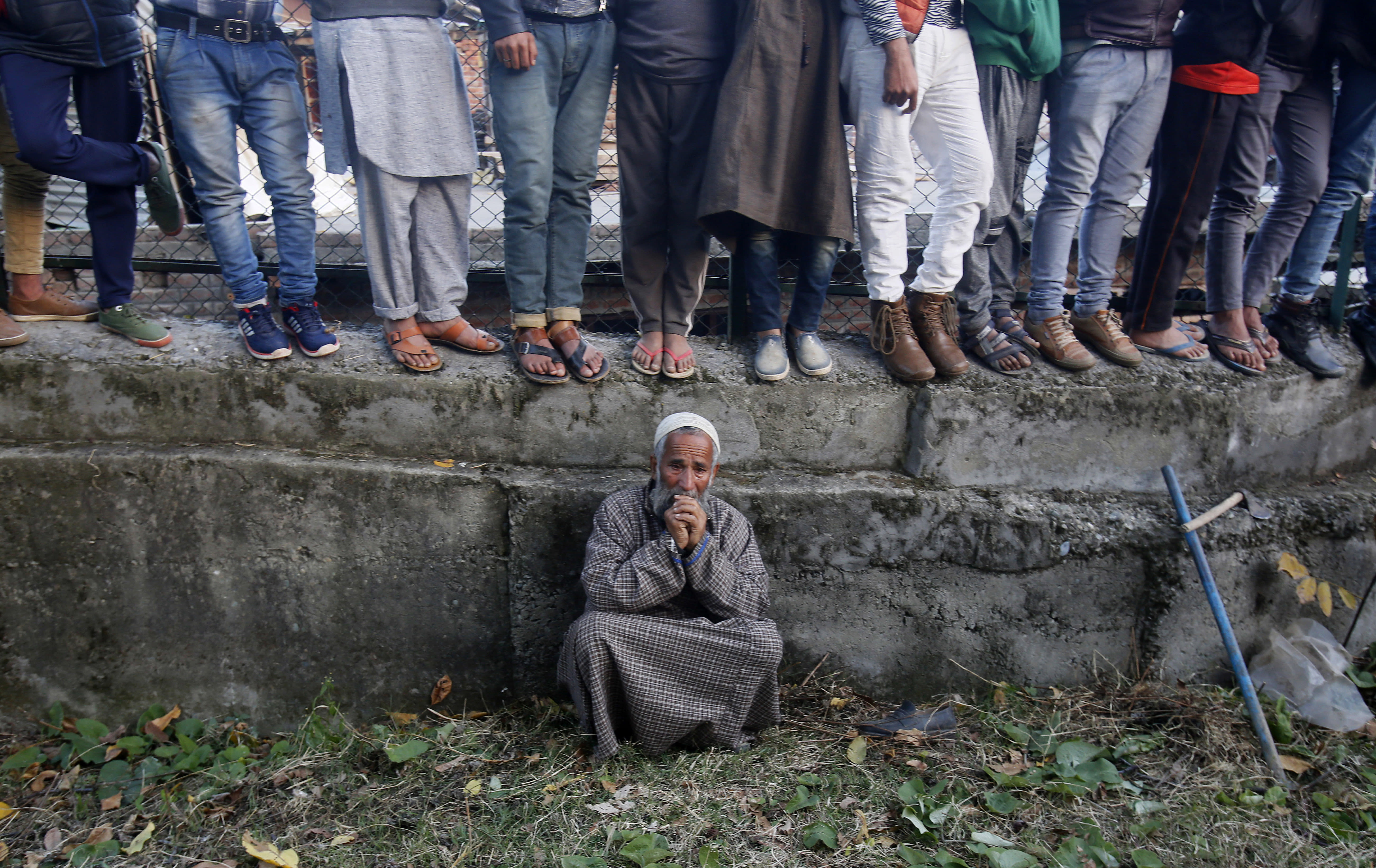 An elderly Kashmiri villager cries during the funeral of Uzair Mushtaq in Kulgam 75 Kilometers south of Srinagar, Indian controlled Kashmir, Sunday, Oct. 21, 2018. Three local rebels were killed in a gunbattle with Indian government forces in disputed Kashmir on Sunday, and six civilians were killed in an explosion at the site after the fighting was over, officials and residents said. (AP Photo/Mukhtar Khan)