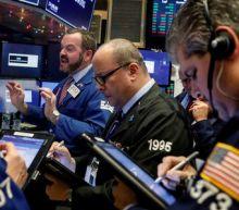 Wall Street climbs on rising tax-cut hopes; Nasdaq breaks above 7,000