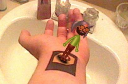 Arttoo: 3DS fan gets AR card tattoo