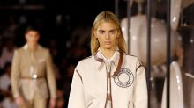 A blonde Kendall Jenner joins Bella Hadid and Gigi Hadid on the catwalk at Burberry's London Fashion Week show