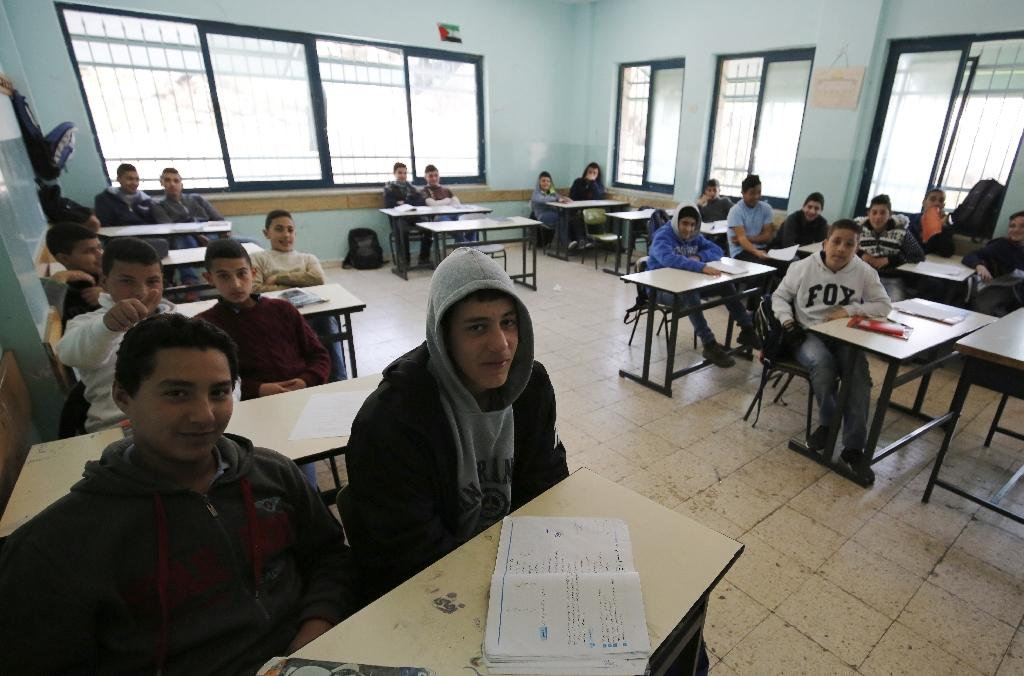 A study by Israeli and Palestinian researchers has found that education on both sides presents the other as the enemy (AFP Photo/ABBAS MOMANI)
