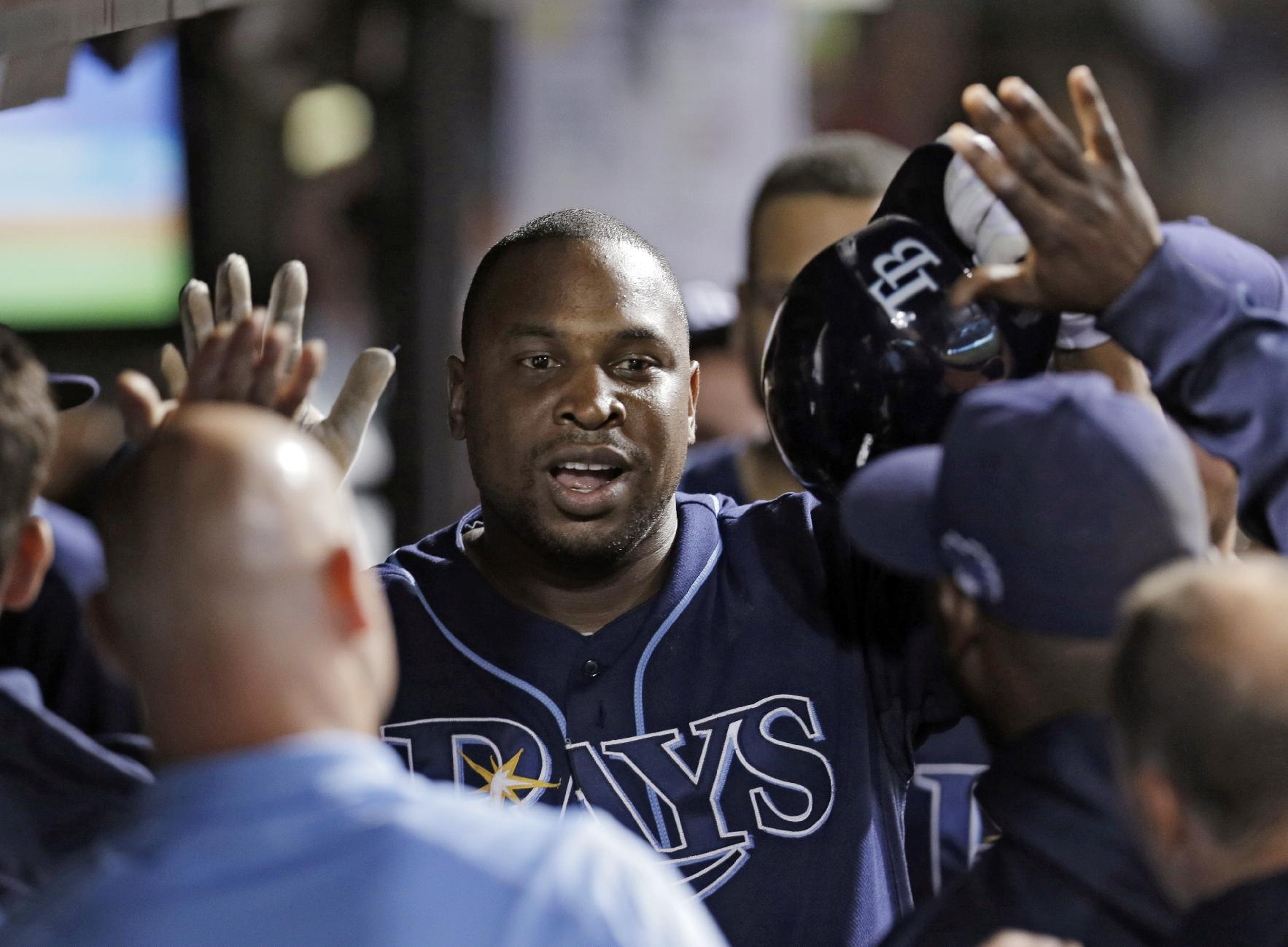 Tampa Bay Rays' Delmon Young is greeted in the dugout after a solo home run off Cleveland Indians starting pitcher Danny Salazar in the third inning of the AL wild-card baseball game Wednesday, Oct. 2, 2013, in Cleveland. (AP Photo/Tony Dejak)