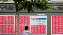 Asian shares inch up as cautious investors await U.S. data, earnings