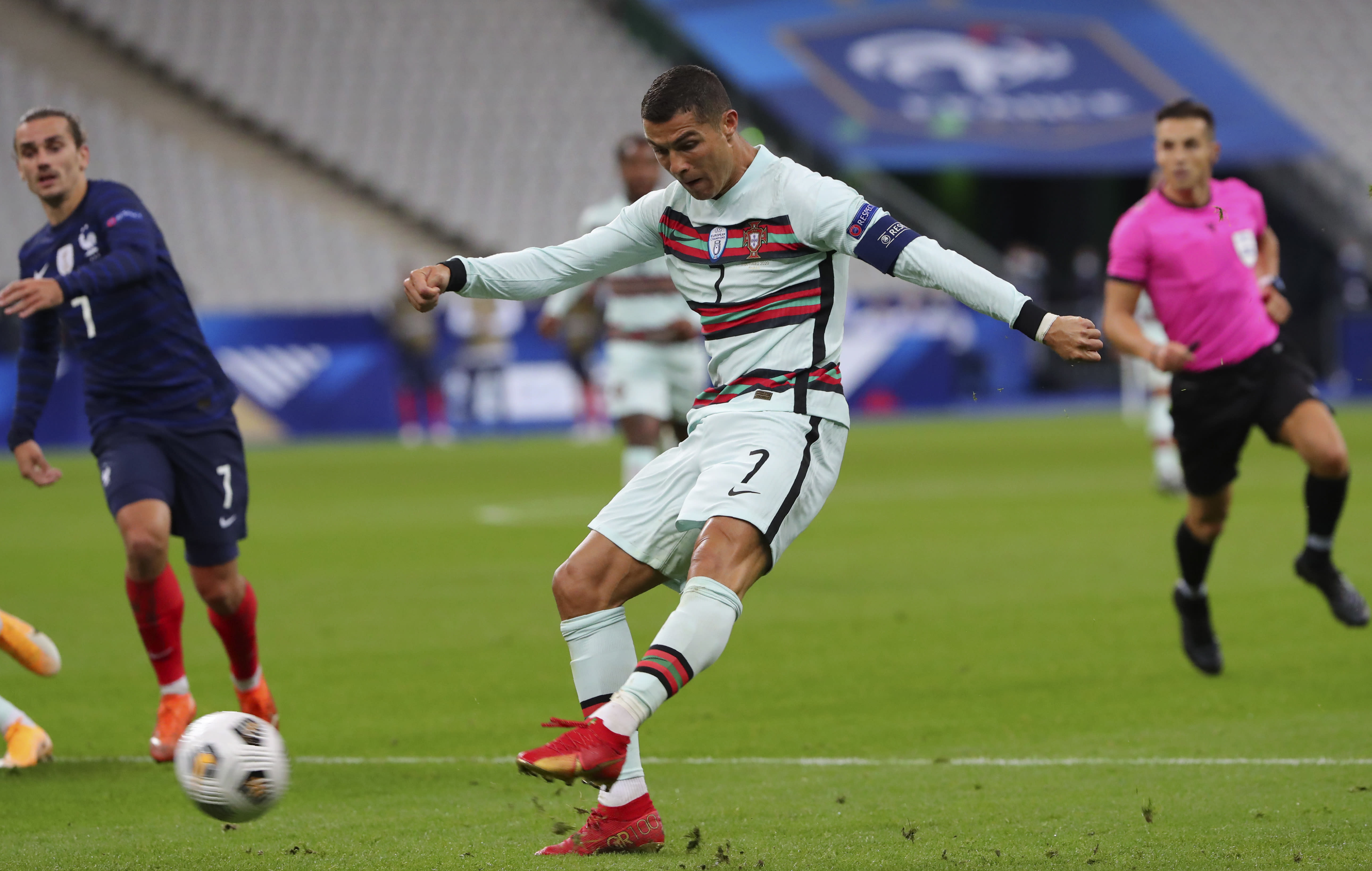 Portugal's Cristiano Ronaldo attempts a shot at goal during the UEFA Nations League soccer match between France and Portugal at the Stade de France in Saint-Denis, north of Paris, France, Sunday, Oct. 11, 2020. (AP Photo/Thibault Camus)