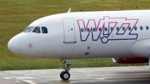 """Wizz says suffered brief rostering issue, rejects Ryanair """"chaos"""" charge"""