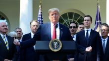 Trump threatens to send military against immigrant 'onslaught'