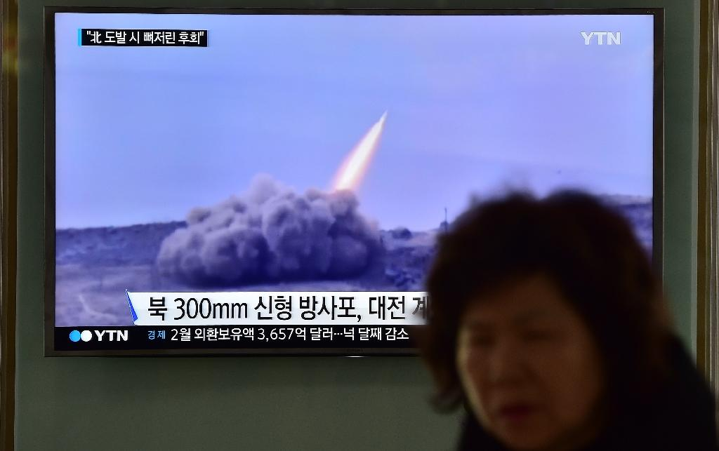 A public TV screen shows file footage of a North Korean missile test, at a railway station in Seoul (AFP Photo/Jung Yeon-Je)