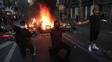 Powerful image shows protesters in Paris kneeling as chaos breaks out