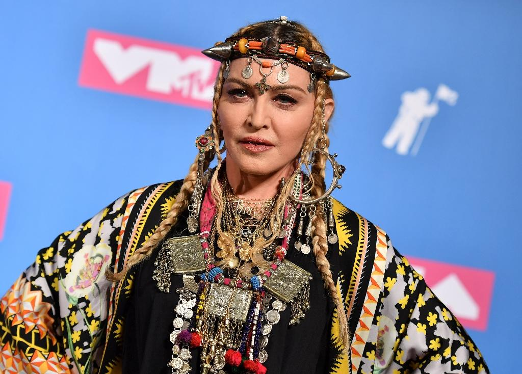 Pop icon Madonna has landed her ninth number one album on the US charts (AFP Photo/ANGELA WEISS)