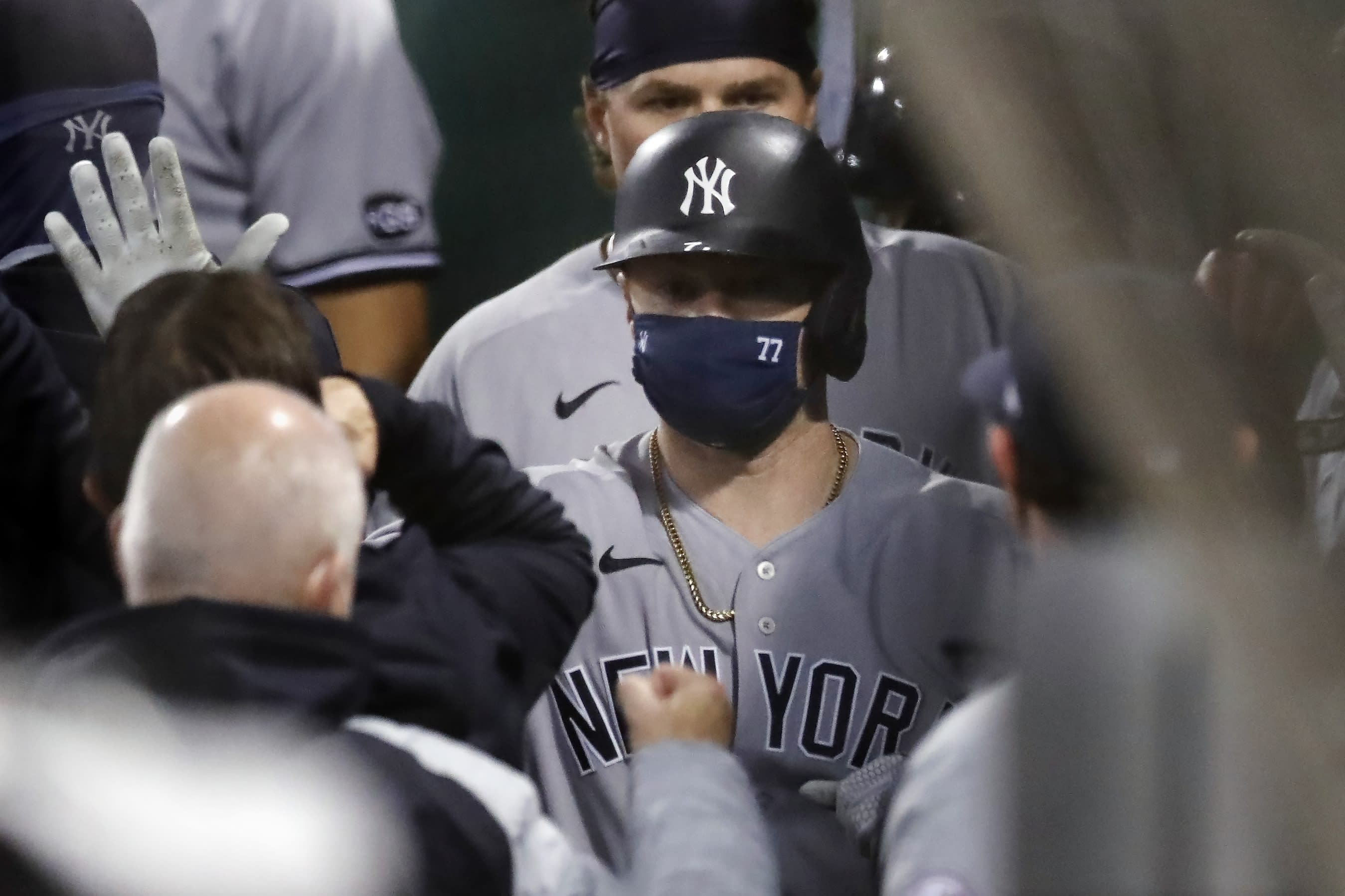 New York Yankees' Clint Frazier (77) celebrates his two-run home run that also drove in Luke Voit, behind, during the fifth inning of a baseball game against the Boston Red Sox, Saturday, Sept. 19, 2020, in Boston. (AP Photo/Michael Dwyer)
