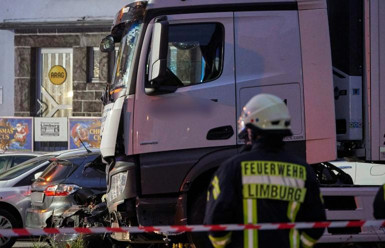 Police cordoned off the site up as tow trucks removed the damaged cars one by one (AFP Photo/Sascha Ditscher)