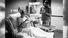 Teacher photographed completing lesson plans while in labor