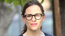 Jennifer Garner's Pride Look Includes Mom Jeans & Gucci Sneakers