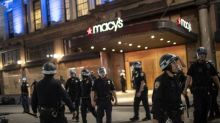 Cuomo lashes out at New York mayor and police after night of violence sees Macy's looted