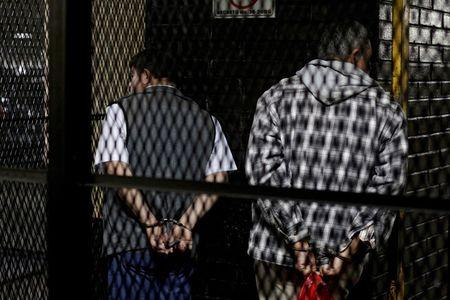 Former Guatemalan Army Colonel Esteelmer Reyes Giron (L) and ex-military commissioner Heriberto Valdez stand handcuffed in a cage after the verdict was given in the Sepur Zarco case in Guatemala City, Guatemala, February 26, 2016. A judge sentenced Giron to 120 years and ex-military commissioner Valdez to 240 years in prison for committing crimes against humanity, as well as sexual violence and slavery against fifteen indigenous women of the Mayan ethnic Q'eqchi group, between 1982 to 1986 at the military base of Sepur Zarco, during Guatemala's bloody 36-year civil war, local media reported. REUTERS/Josue Decavele TPX IMAGES OF THE DAY - RTS87MF