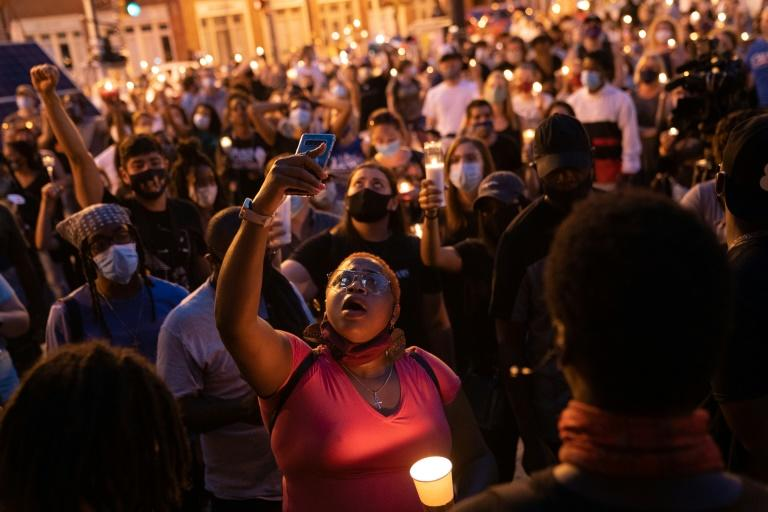 People in Atlanta, Georgia took part on July 19, 2020 in a candlelight vigil honoring civil rights leader and Georgia congressman John Lewis; after a week of honors, he will be laid to rest in Atlanta on July 30 (AFP Photo/Elijah Nouvelage)