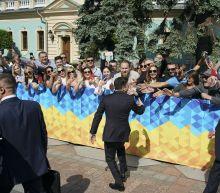 The Latest: Ukraine prime minister to quit in symbolic move