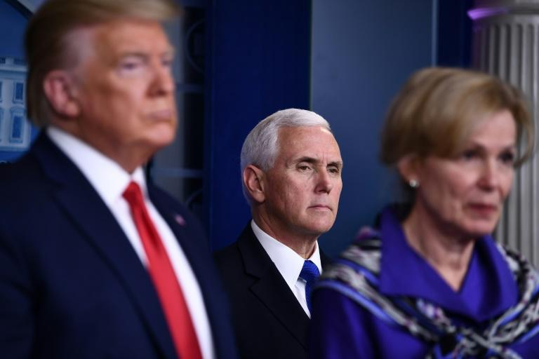 US Vice President Mike Pence (C) listens in March during the daily White House briefing on Covid-19