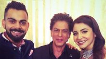 Photo: Virat Kohli and Anushka Sharma are all smiles as they pose with Shah Rukh Khan at their reception