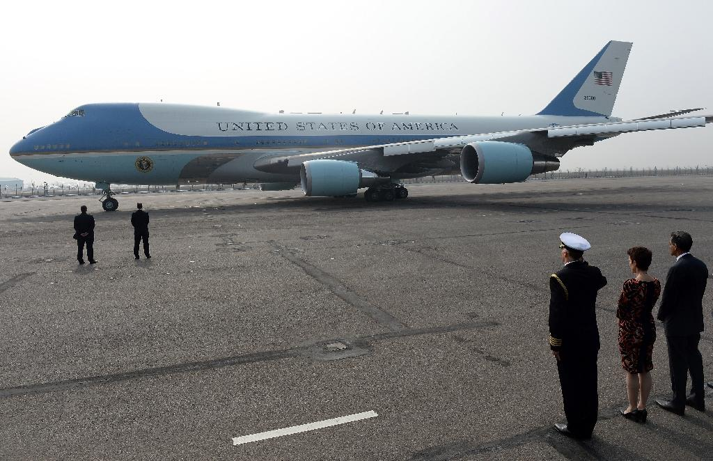 """Air Force One, there are actually two of them, are an instantly recognizable emblem of American power with light blue-and-white livery, """"United States of America"""" emblazoned along their fuselage and a large US flag on the tail fin (AFP Photo/Prakash Singh)"""