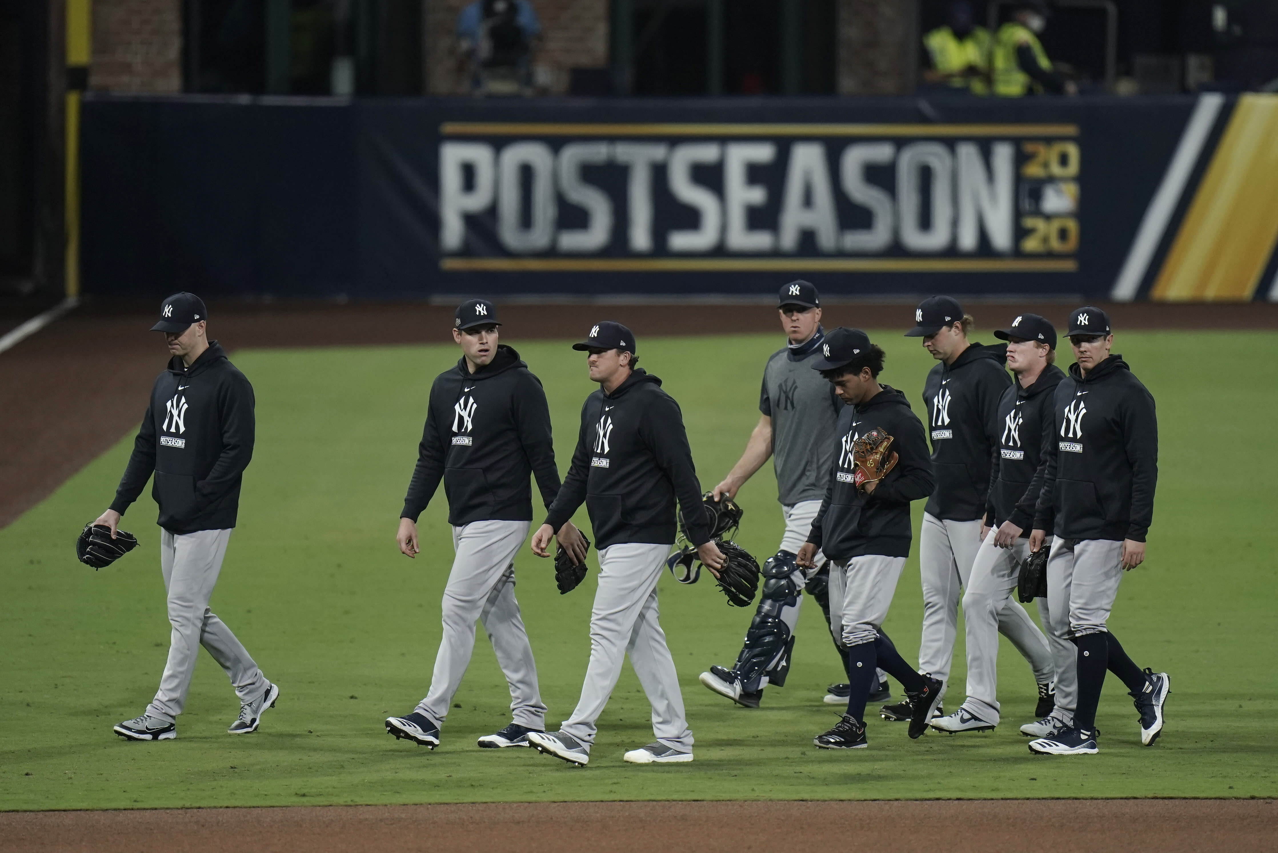 New York Yankees walk to the dugout following Game 5 of the baseball team's AL Division Series against the Tampa Bay Rays, Friday, Oct. 9, 2020, in San Diego. Tampa Bay won 2-1 to advance to the AL Championship Series. (AP Photo/Jae C. Hong)