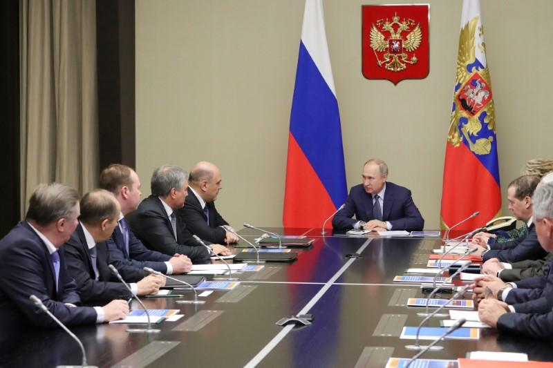 Russian President Vladimir Putin chairs a meeting with members of the Security Council at the Novo-Ogaryovo state residence outside Moscow