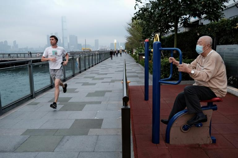 Hong Kong's expat community disagree over how to respond to the coronavirus (AFP Photo/Anthony WALLACE)
