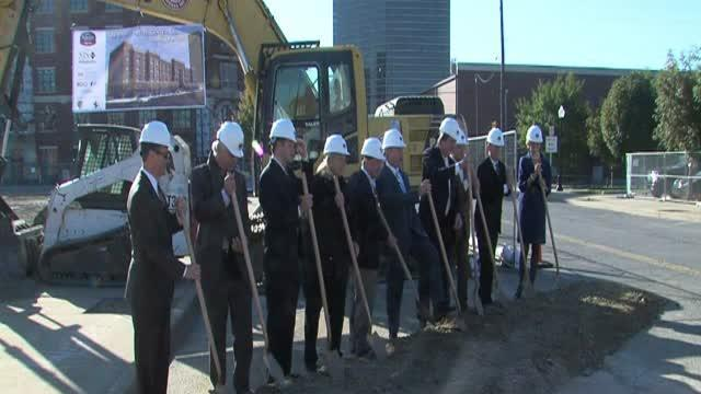 Officials break ground on downtown hotel
