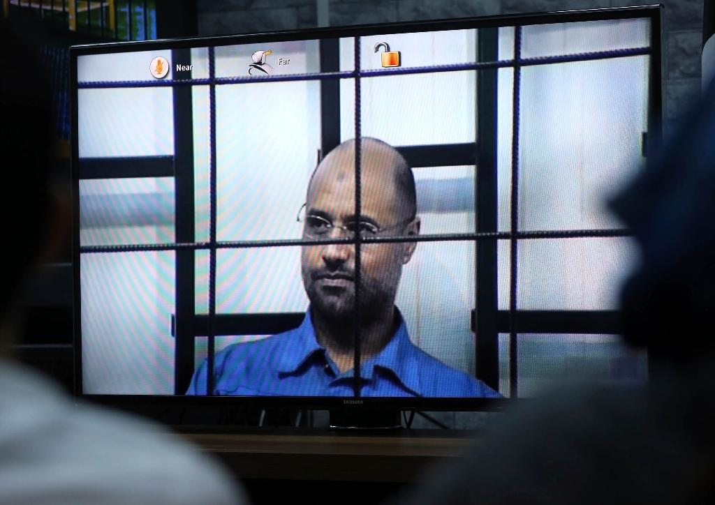 Seif al-Islam, pictured on trial in Libya in 2014, can face a crimes against humanity case, following a ruling by ICC judges