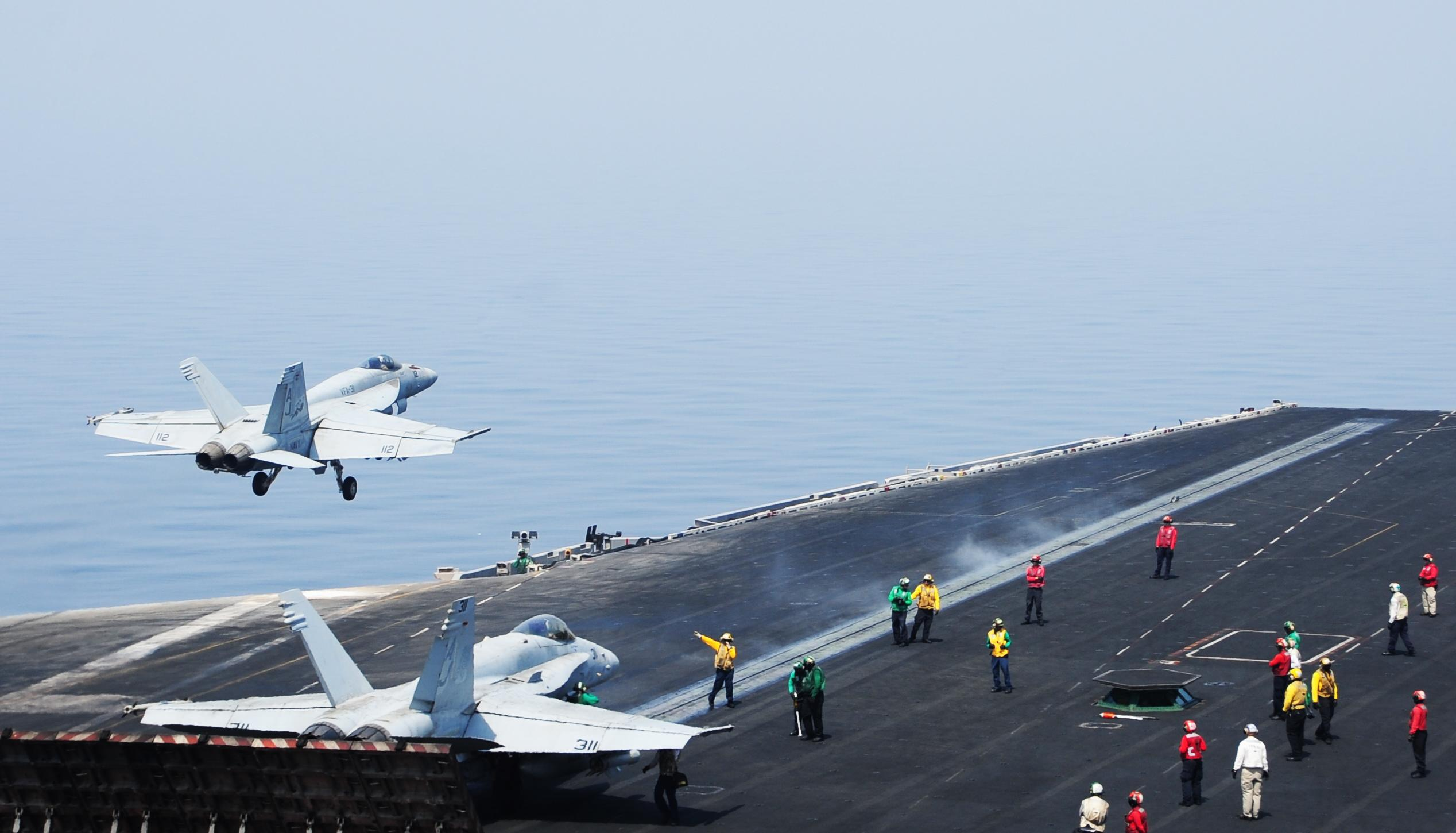 This US Navy photo obtained August 8, 2014 shows sailors directing aircraft, as an F/A-18E Super Hornet takes off from the aircraft carrier USS George H.W. Bush on August 1, 2014 in the Gulf (AFP Photo/Joshua Card)