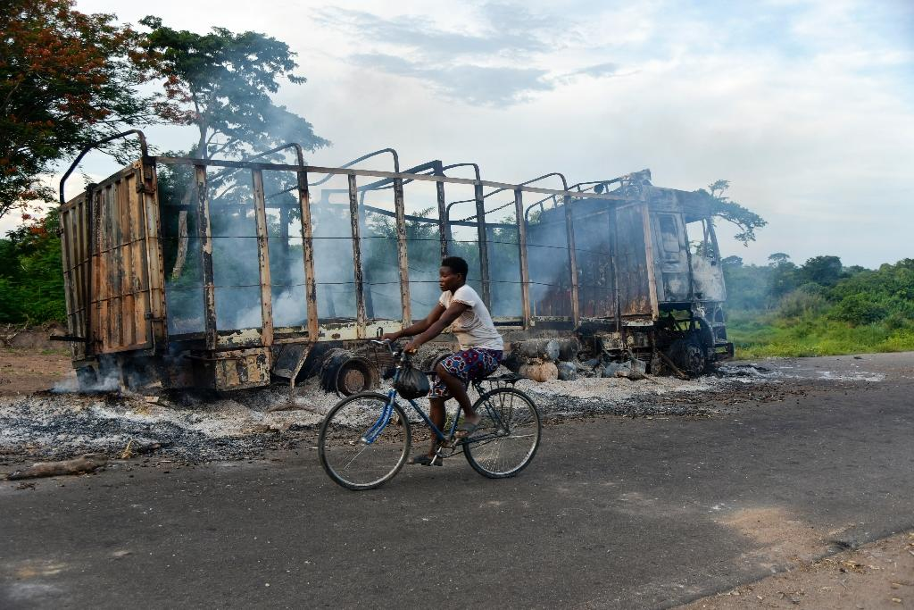 As well as the killings, houses, cars and other property were burned during the violence (AFP Photo/Sia KAMBOU)