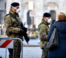 Italy locks down 'hot spot' cities; WHO says coronavirus 'not yet' a pandemic