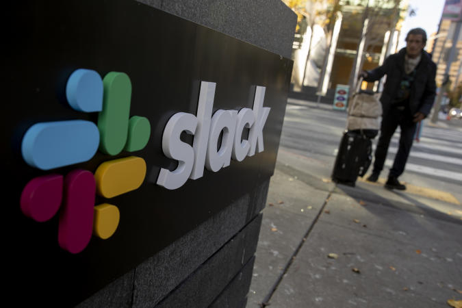 SAN FRANCISCO, CA - DECEMBER 01: A pedestrian walks past a Slack logo outside its headquarters on December 1, 2020 in San Francisco, California. Cloud-based enterprise software company Salesforce announced on Tuesday that it will purchase the popular workplace-chat app for $27.7 billion. (Photo by Stephen Lam/Getty Images)