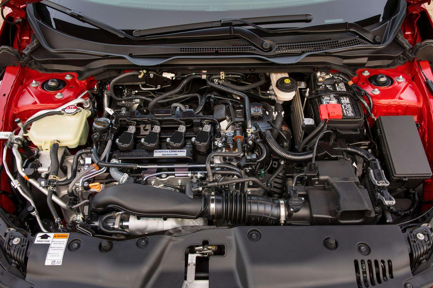 """<p>Let's get this out of the way up front: Honda's latest Civic Si lacks VTEC, otherwise known as variable valve timing and lift electronic control. <a href=""""https://www.caranddriver.com/features/g15381097/kicking-in-the-history-of-honda-si-cars-in-america/"""" rel=""""nofollow noopener"""" target=""""_blank"""" data-ylk=""""slk:In Civic Si cars dating back"""" class=""""link rapid-noclick-resp"""">In Civic Si cars dating back</a> to the late 1990s, VTEC has famously registered as a character switchover at higher engine speeds, when a more aggressive cam profile took over and gave the four-cylinders a rowdy bawl and more power. In its place, the 2019 Civic Si's 1.5-liter engine uses a turbocharger and direct fuel injection to kick out 205 horsepower—exactly the same amount as its VTEC-equipped, non-turbocharged, 2.0-liter predecessor.</p>"""