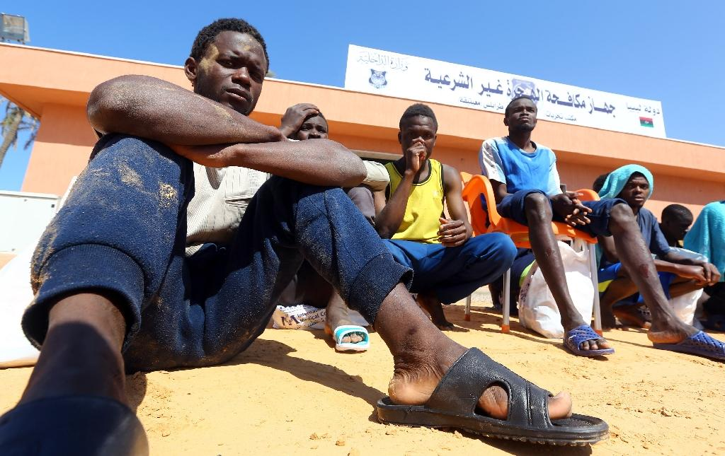 African migrants rescued after their boat sank off Libya on April 13, 2017, with at least 97 people reported missing (AFP Photo/MAHMUD TURKIA)