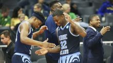 Lamar Odom visits locker room after Rhode Island's opening-round victory