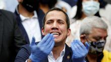 Britain recognises Juan Guaido as president of Venezuela after dispute over gold