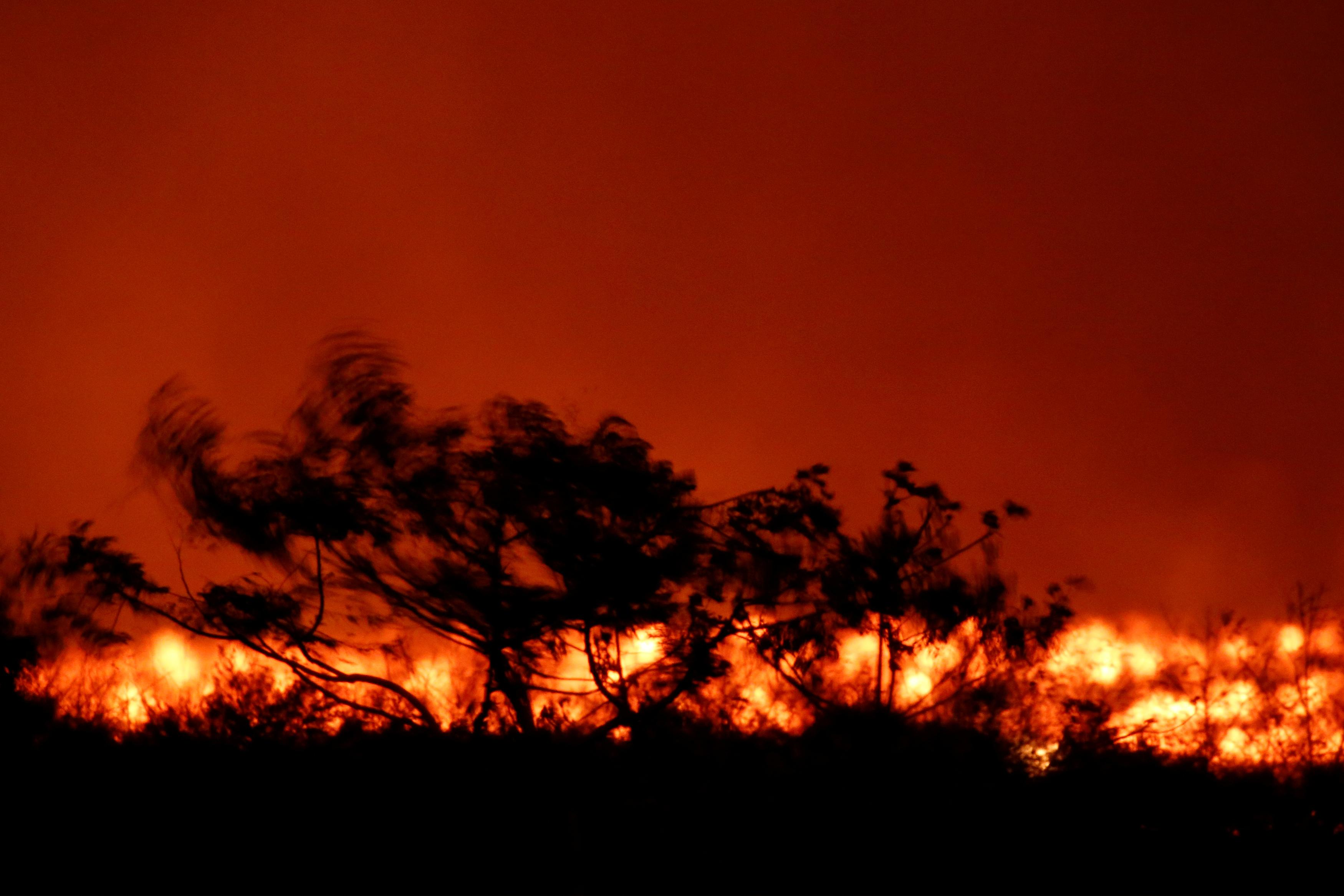 <p>In a long-exposure photograph, lava flows on the outskirts of Pahoa during ongoing eruptions of the Kilauea Volcano in Hawaii, June 6, 2018. (Photo: Terray Sylvester/Reuters) </p>