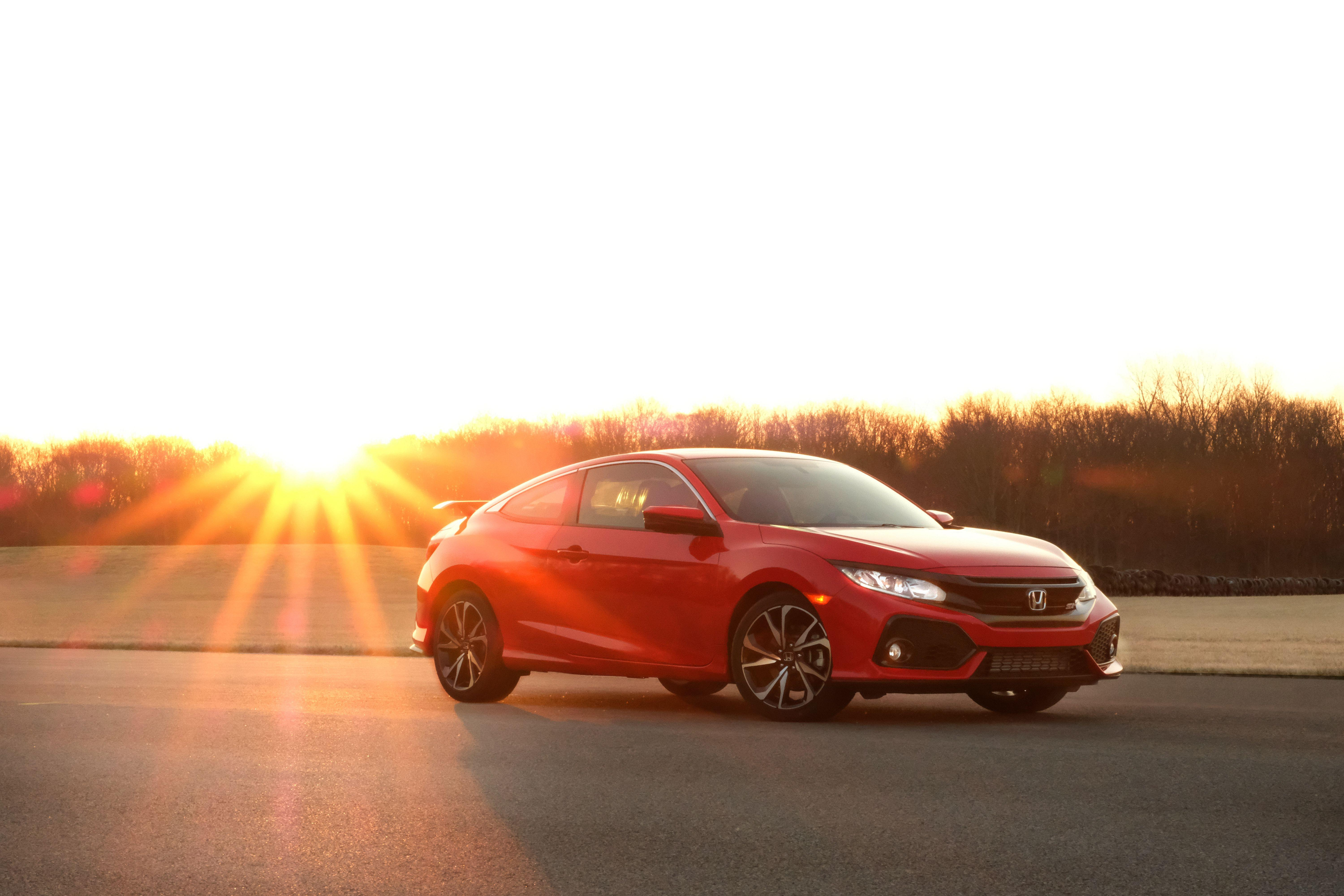 """<p>Easily the best-handling front-wheel-drive car on the market today, <a href=""""https://www.caranddriver.com/honda/civic-si"""" rel=""""nofollow noopener"""" target=""""_blank"""" data-ylk=""""slk:Honda's Civic Si coupe"""" class=""""link rapid-noclick-resp"""">Honda's Civic Si coupe </a>(and its mechanically identical four-door sedan sibling) is a performance bargain. It is quick, thanks to its turbocharged four-cylinder engine, and it is fun to drive, thanks to its six-speed manual transmission and well-sorted chassis. The Si model exists between the mainstream Civic lineup and <a href=""""https://www.caranddriver.com/honda/civic-type-r"""" rel=""""nofollow noopener"""" target=""""_blank"""" data-ylk=""""slk:the bonkers, 306-hp Civic Type R"""" class=""""link rapid-noclick-resp"""">the bonkers, 306-hp Civic Type R</a>, and shares <a href=""""https://www.caranddriver.com/features/a25252134/10best-cars-2019/"""" rel=""""nofollow noopener"""" target=""""_blank"""" data-ylk=""""slk:a 10Best Cars award from us"""" class=""""link rapid-noclick-resp"""">a 10Best Cars award from us</a> with the latter. We've also run the Si at our <a href=""""https://www.caranddriver.com/features/a15082147/honda-civic-si-at-lightning-lap-2017-feature/"""" rel=""""nofollow noopener"""" target=""""_blank"""" data-ylk=""""slk:annual Lightning Lap track test in 2017"""" class=""""link rapid-noclick-resp"""">annual Lightning Lap track test in 2017</a>, where it was the only car that year to gain speed through Virginia International Raceway's treacherous high-speed uphill ess-curves. To see what sets it apart from the regular Civic, swipe on!</p>"""