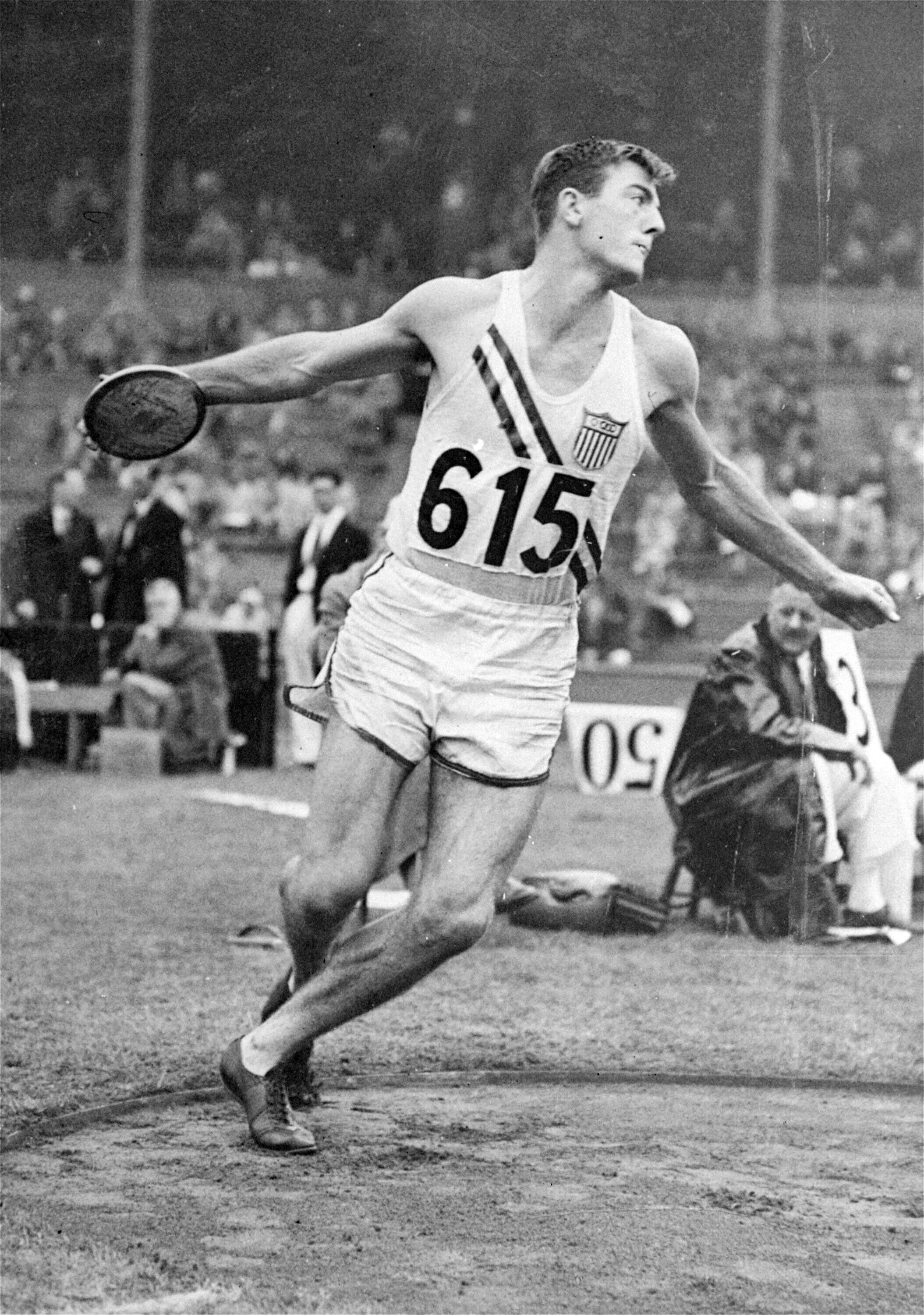 FILE - In this Aug. 6, 1948, file photo, Bob Mathias, of the United States, throws the discus during the decathlon competition at Wembley Stadium at the London Summer Olympics. The Associated Press was in London when it staged the first Olympics after World War II. Bob Mathias took up decathlon at the suggestion of his high school coach in Tulare, California. Less than three months later he qualified for the 1948 Games and soon found himself standing in Wembley Stadium. Mathias won the decathlon and, at 17, became the youngest male winner of a track and field event in Olympic history. (AP Photo, File)