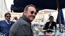 Kevin Spacey photographed with a big smile in Italy where he's filming comeback movie