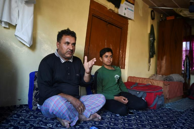 13-year-old Shayan (R) says he can't study or connect with any of his friends (AFP Photo/Punit PARANJPE)
