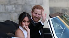 Prince Harry and Meghan Markle take a left-hand drive Jaguar to their reception