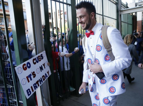 Kris Bryant spent some time on his road trip attire. (AP Photo)