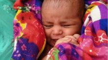 Ganges river: India boatman praised for saving baby girl floating in a box