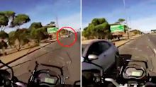 Motorcyclist's horrific close call after stolen car speeds down wrong lane
